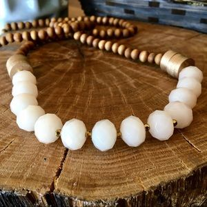 White, Gold and wooden necklace.